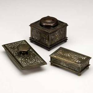 tiffany studios three bronze desk set pieces in the pine needle pattern two of them in dore patina lined in caramel slag glass stamp box no 218 rolling blotter no 995 and inkwell no 8