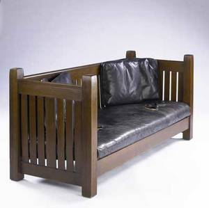 L  jg stickley crib settle no 223 with vertical slats all around and dropin spring seat recovered in black leather unsigned 39 x 84 x 32