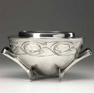 Liberty  co tudric pewter rose bowl designed by archibald knox with two handles and four feet embossed with a stylized rose hips a few small nicks stamped register number and tudric 6 14 x 12