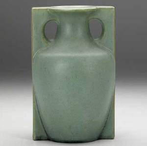 Teco baluster vase with two fullheight buttresses covered in smooth matte green glaze professional restoration to small chip at rim stamped teco 7 x 4 14