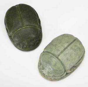 grueby two large scarab paperweights one covered in matte green glaze the other in sea foam green two chips to footring of latter both stamped with grueby faience medallion 4 x 2 12