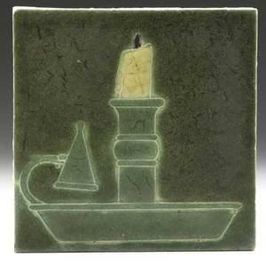 Grueby tile decorated in cuenca with a light green chamberstick and burntout yellow candle on deep green ground very light wear to surface signed kd 6 sq