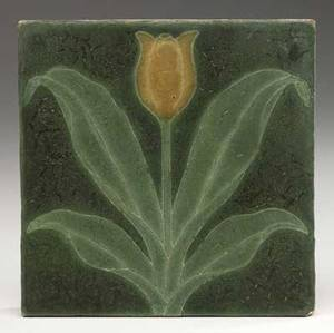 Grueby tile decorated in cuenca with a golden tulip and light green leaves against a rich leathery matte green glaze small chip to corner signed gm 6 sq