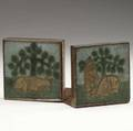 grueby pair of bookends made of two different tiles of the same series decorated in cuenca one with a donkey the other with two bears set in hammered copper mounts medium patina unmarked tiles