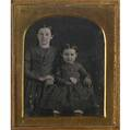 Two family portraits one of daughters other of parents two fourthplate daguerreotypes cased together in case with motherofpearl decoration