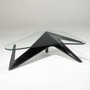Italian coffee table with shaped glass top over angular ebonized wood base 15 12 x 51 x 36