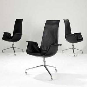 Preben fabricius and jorgen kastholm set of four highack chairs upholstered in black leather on steel frames on casters 43 34 x 29 x 28