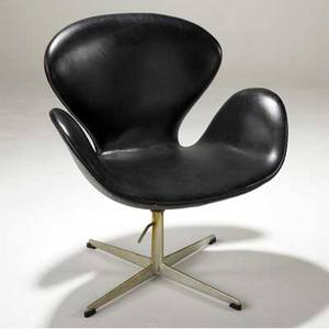 Arne jacobsen  fritz hansen swan chair upholstered black leather on aluminum swivel base fritz hansen label 33 34 x 28 12 x 27