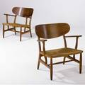 Hans wegner pair of teak armchairs with woven grass seats branded hans wegner  carl hansen  son odense denmark 28 14 x 27 12 x 22 12