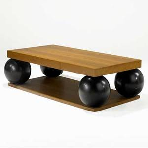 Juan montoya large coffee table with bookmatched walnut top with two drawers supported by four ebonized spheres provenance juan montoya collection 18 x 64 x 34