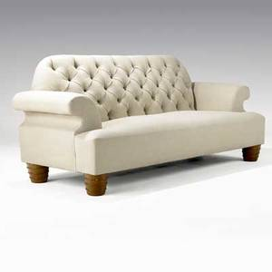 Juan montoya sofa upholstered in tan linen with tufted backrest on turned wooden feet provenance juan montoya collection 38 x 88 x 34