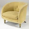 Robert couturier attr barrel chair upholstered in cream velvet with gilded and painted front legs and rear sabre legs 28 x 32 x 24