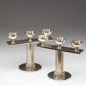 Jean despres pair of silverplated candlesticks with hammered patterning and fluted stem signed j despres 8 14 x 10 x 5