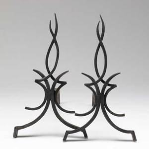 Raymond subes pair of castiron andirons the uprights of stylized flame design 15 34 x 9 x 21 14