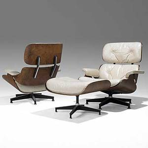 Charles and ray eames herman miller two rosewood and leather lounge chairs and single ottoman no 670 671 note uncommonly upholstered in offwhite leather herman miller upholstery label to one