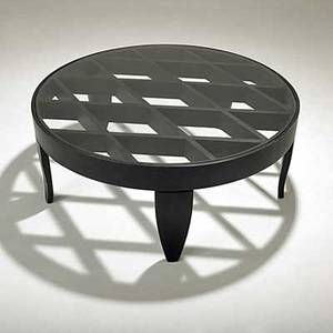 After gio ponti ebonized wood coffee table with inset plate glass top unmarked 16 12 x 41 14 dia