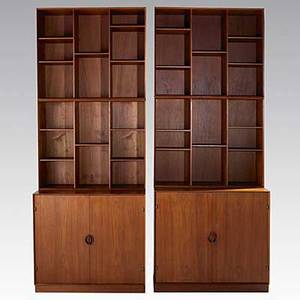 Peter hvidt and orla molgaardnielsen soberg mobler pair of dovetailed teak cabinets with four bookshelves foil label to one bookcase lower cabinet 33 x 35 x 19 each bookcase 30 x 35 12 x