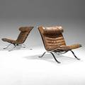 Arne norel aneby pair of chromed steel and leather lounge chairs 1960s each with manufacturer labels 31 x 25 12 x 39