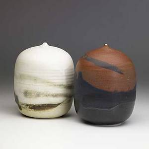 Toshiko takaezu two porcelain moonpots one with rattle both incised tt 7 x 5 and 7 12 x 5 14