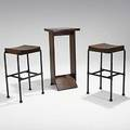 Pierre chareau pair of mahogany and steel stools and weighted high table used at the grand hotel at tours france 1926 unmarked stools 28 x 16 12 x 14 table 36 x 17 34 x 13 12