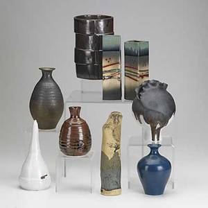 Artisanal ceramics nine assorted vessels in various shapes and glazes tallest 9 12 x 2 12 dia