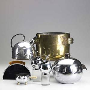 Art deco brass and chrome thirteen pieces include two penguin servers chrome teapot two watering can creamers brass oval ice bucket