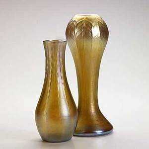Tiffany studios two gold favrile glass vases one with peacock feather pattern each etched lc tiffany inc favrile one numbered 15394311n the other 1558 11 x 4 12 and 9 x 3 34