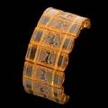 Lalique griffons fourteen amber glass pieces on elastic bands no 1337 etched r lalique each piece 1 14 x 12