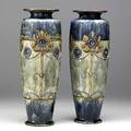 Royal doulton pair of stoneware vases decorated in the aesthetic movement with blooming flowers and beaded strands lion and crown royal doulton stamps 6621 lb 635 14 12 x 5