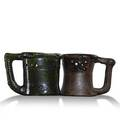 George ohr two puzzle mugs one with rabbit handle green one mishapen one with script signature the other stamped each 3 34 x 5