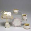Belleek approx fortytwo pieces include covered butter dish seven various creamers bell easter egg and five star shaped dishes etc