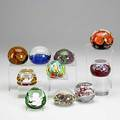 Ten art glass paperweights baccarat sulphide of peter the great baccarat sulphide of charlemagne 1976 maude and bob st clair orange and purple floral vandermark green purple and yellow millefiore