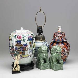 Asian decorative arts famille rose covered ginger jar imari covered ginger jar with figural finial canton light base pair of celadon glazed foo dogs and ivory figure of a man flying a kite 20th c