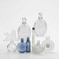 Lalique eight perfume bottles figural stopper clairefontaine lotus form two lilacs for worth dahlia magic of lancome and two cobalt blue all 20th c tallest 5 14