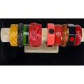 Bakelite bangles nine pieces with polka dots laminated or carved widest 1 34
