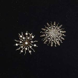 Bejeweled starburst pins two 14k yg pins 19th20th c one set with oec diamonds approx 75 ct tw the other set with seed pearls 125 gs gw