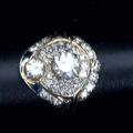 Diamond cocktail ring assembled art deco style large center stone with accent diamond surrounded by melee diamonds set in platinum 20th c approx 1 ct center stone approx 60 ct melee size