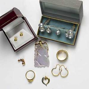 Mens and womens gold jewelry black baroque pearl cufflinks and buttons set in 14k wg modern design ring set with rubies in 18k yg carved purple jade pendant with 14k yg findings 18k yg bead earr