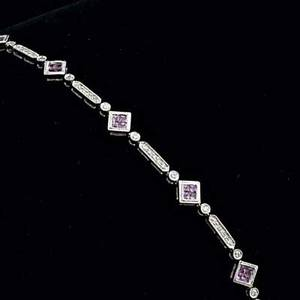 Pink sapphire and diamond link bracelet 14k wg brilliant cut diamonds approx 59 ct tw and invisibly set clusters of radiant cut sapphires approx 80 ct tw 73 gs 7