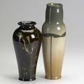 Owens weller owens lotus tall vase painted with lotus leaves repair to base and weller louwelsa baluster vase decorated with fish chip to base both with impressed marks taller 12