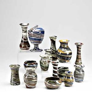 Desert sands pottery grouping approx fifty pieces includes vases in various shapes bowls salt and peppers etc tallest 12