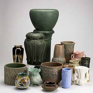 Art pottery group lot approx sixteen pieces include gouda limoges hull niloak red wing weller attr and others spurious grueby mark to one tallest 21
