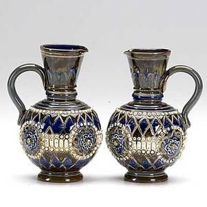 Royal doulton pair of stoneware jugs minor fleck to rim of one both marked 5
