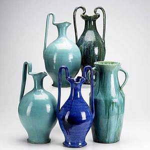 North carolina pottery five pieces include two ewers and three urns tallest 18