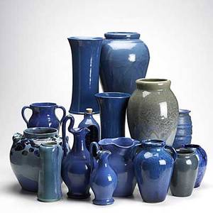 Art pottery grouping fifteen pieces include north carolina style pottery and an english barrel shaped vase tallest 13