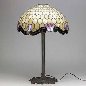 Arts  crafts table lamp with hemispheric slag glass shade and patinated white metal base with foliate decoration 27 x 18 dia