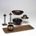 Roycroft seven hammered copper items footed jardinere nut bowl closedin vase card tray and pair of princess candlesticks some with redeveloping patina orb  cross mark together with gustav st