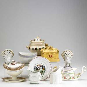 Porcelain and pottery twelve pieces include two parian creamers wedgwood sauceboat pair of peacock vases covered sugar bowl with tray etc tallest 6
