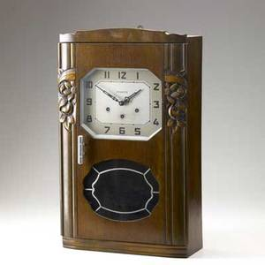 French art deco wall clock walnut with carved decoration and chrome handle marked vedette made in france 24 12 x 14 12 x 6