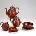 Chinese porcelain orange and black handdecorated tea set includes teapot covered sugar creamer slop bowl and five teacups with saucers tallest 7